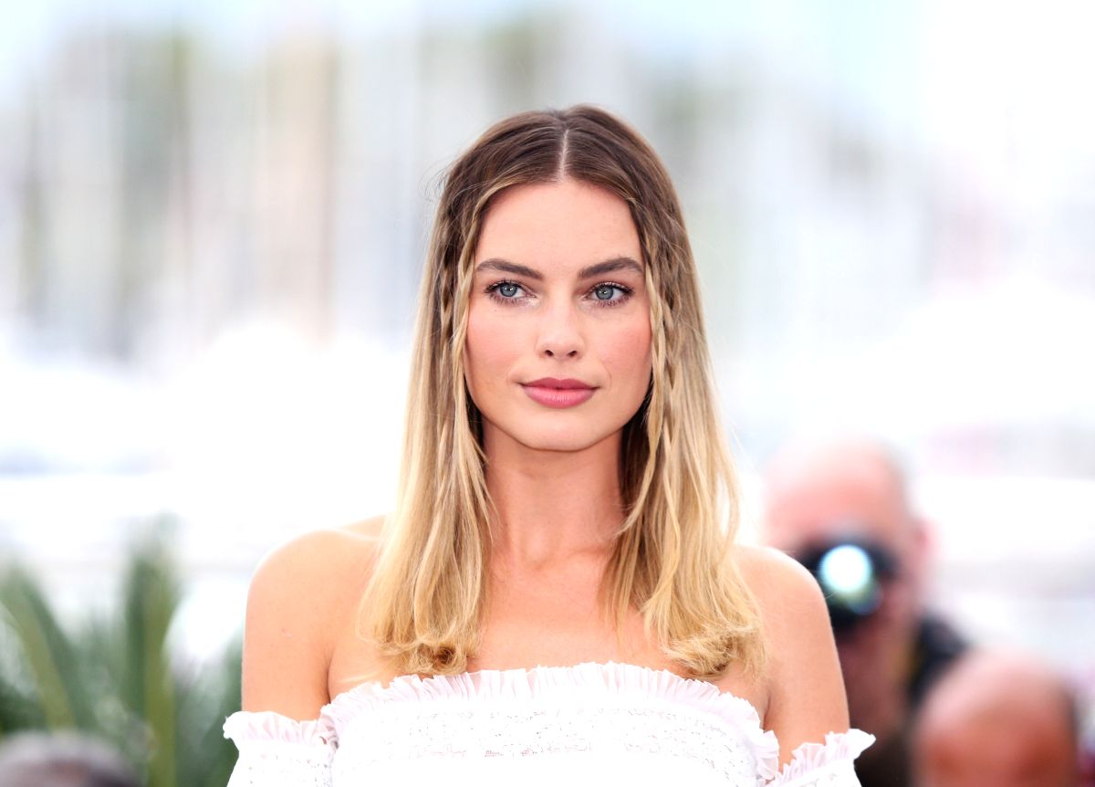 "CANNES, May 22, 2019 (Xinhua) -- Actress Margot Robbie poses during a photocall for ""Once Upon a Time in Hollywood"" during the 72nd Cannes Film Festival in Cannes, France, May 22, 2019. ""Once Upon a Time in Hollywood"" will compete for the Palme d'Or"