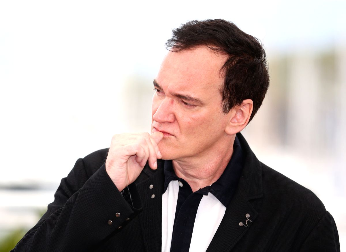 """CANNES, May 22, 2019 (Xinhua) -- Director Quentin Tarantino poses during a photocall for """"Once Upon a Time in Hollywood"""" during the 72nd Cannes Film Festival in Cannes, France, May 22, 2019. """"Once Upon a Time in Hollywood"""" will compete for the Palme"""