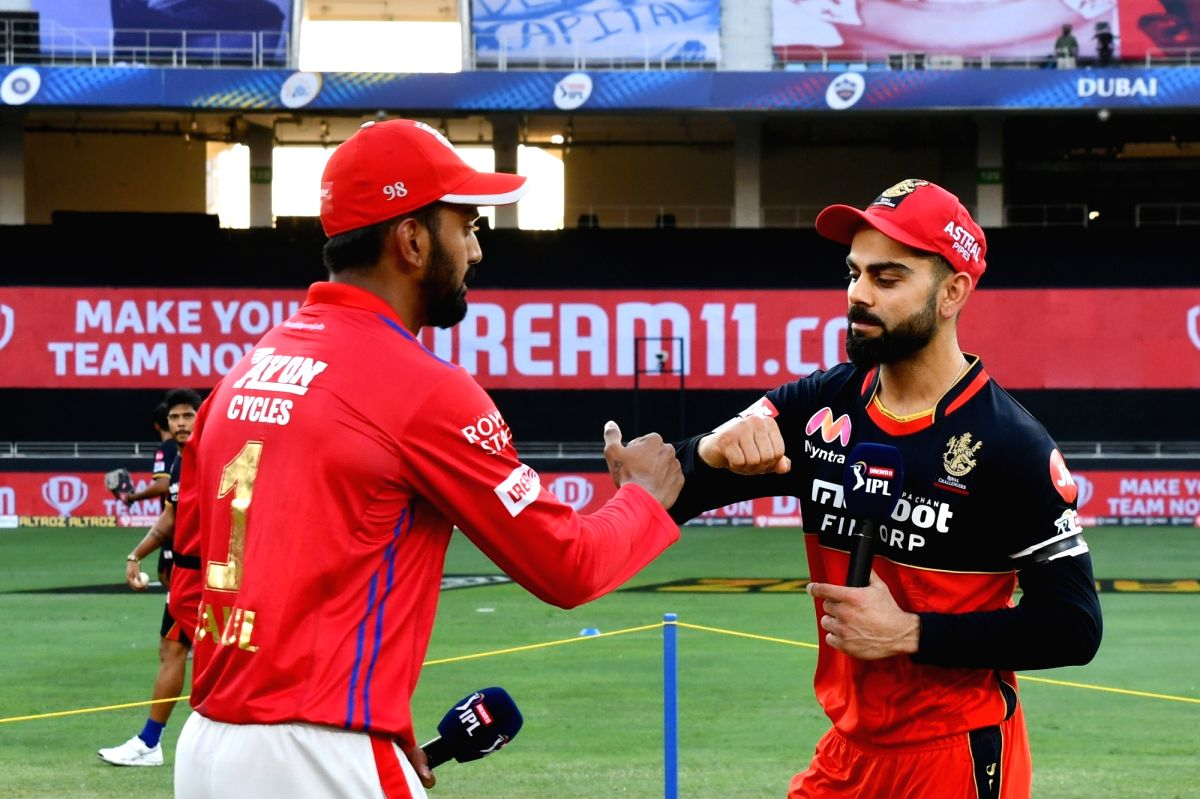 Captain of RCB Virat Kohli, Captain of Kings XI Punjab KL Rahul with Match Referee Javagal Srinath and Commentator Michael Slater at the toss during the match 6 of season 13, Dream 11 Indian Premier League (IPL) between Kings XI Punjab and Royal Chal