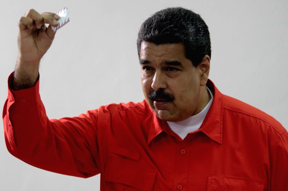 CARACAS, July 30, 2017 (Xinhua) -- Venezuelan President Nicolas Maduro casts his vote during the election for the National Constituent Assembly (ANC), in Caracas, Venezuela, on July 30, 2017. All the polling stations for electing members to the Natio
