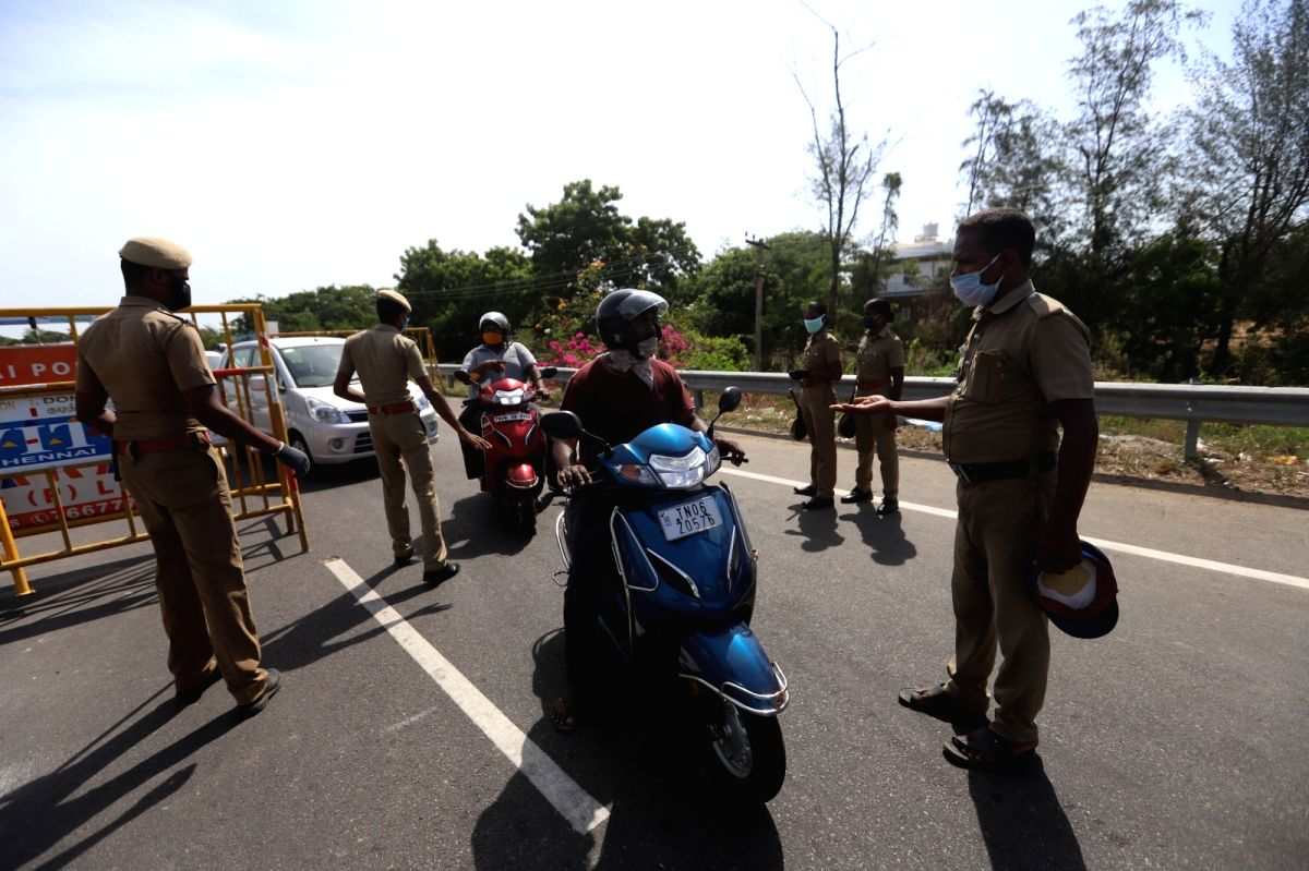 Chennai: Commuters without e-passes being intercepted by police personnel at Chennai Border on June 18, 2020. Though the complete lockdown is set to being only on Friday, the city's borders have already been sealed. Thousands of office-goers and da