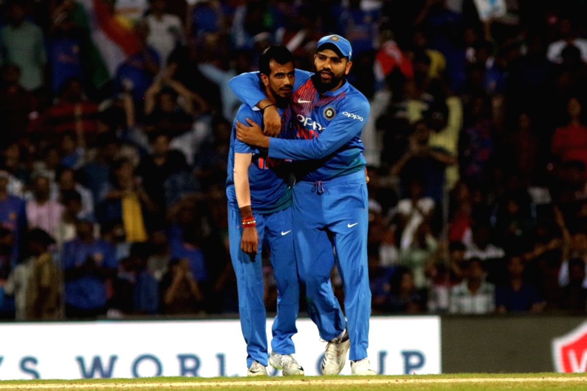 Chennai: India's Rohit Sharma and Yuzvendra Chahal celebrate the dismissal of Shimron Hetmyer during the third and final T20 International match between India and West Indies at the M.A. Chidambaram Stadium in Chennai on Nov 11, 2018.