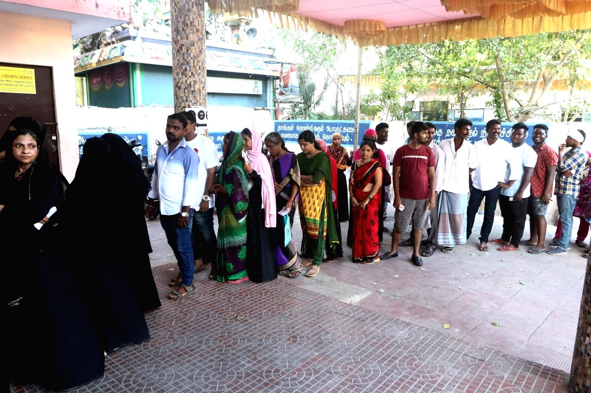 Chennai: People wait in a queue to cast their vote for the second phase of 2019 Lok Sabha elections, at a polling station in Chennai on April 18, 2019.