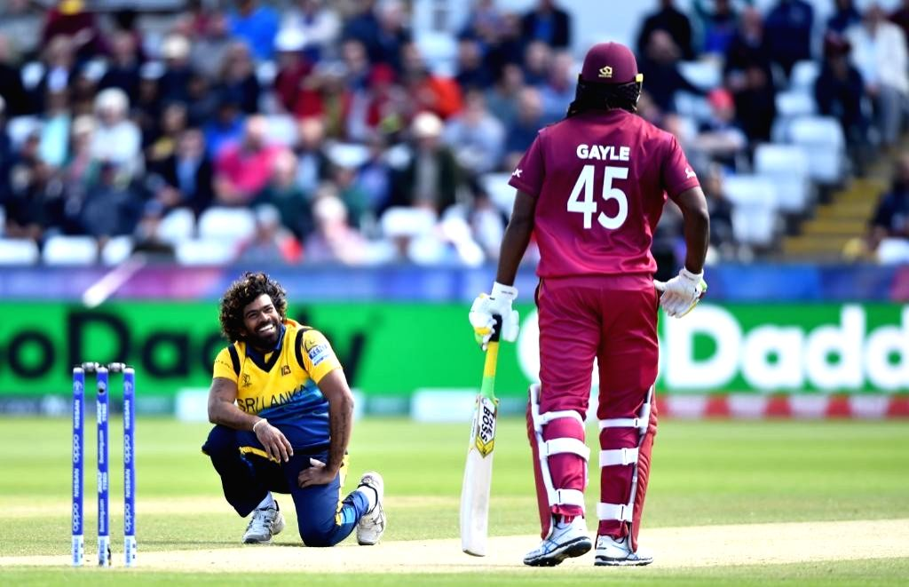 Chester-le-Street: Chester-le-Street: Sri Lanka's Lasith Malinga (L) and West Indies' Chris Gayle (R) during the 39th match of 2019 World Cup between Sri Lanka and West Indies at Riverside Ground in Chester-le-Street, England on July 1, 2019. (Photo
