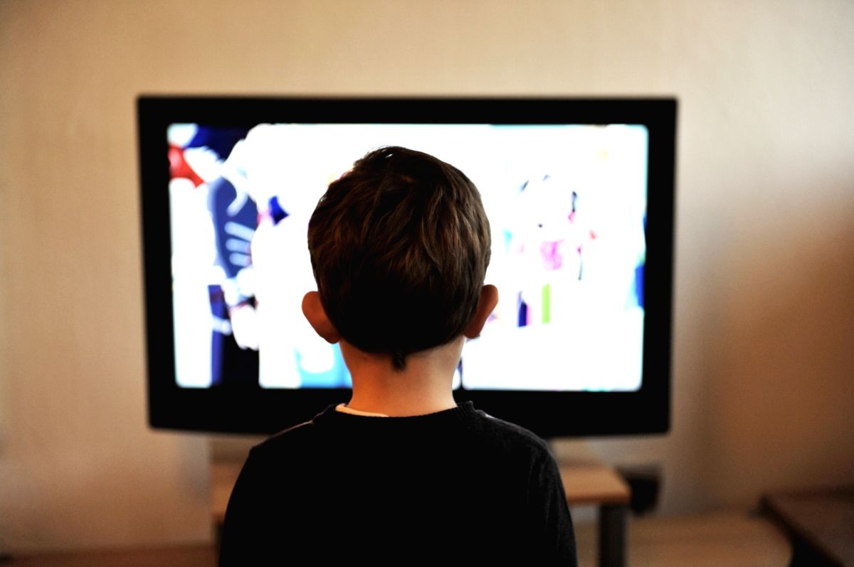 Children watching Television.
