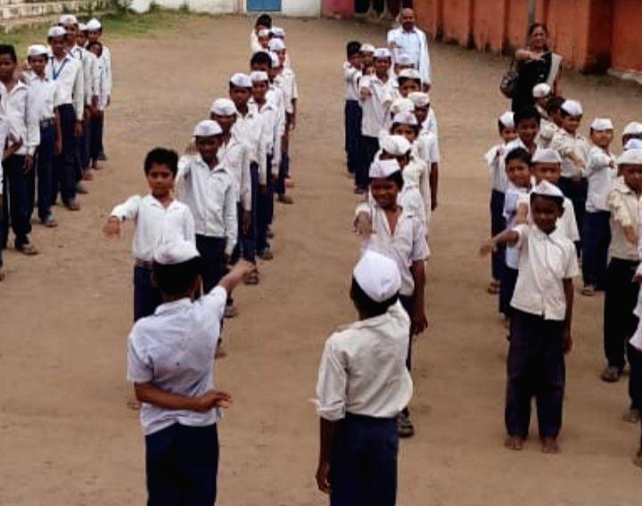 Children wearing Gandhi cap