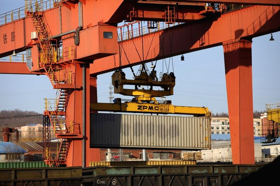 China, Nov. 18 (Xinhua) --  A container is lifted by a gantry crane at Suifenhe Railway Port in Suifenhe, an important Chinese port for trade with Russia, northeast China's Heilongjiang Province. (Photo by Zhang Tao/Xinhua/IANS)