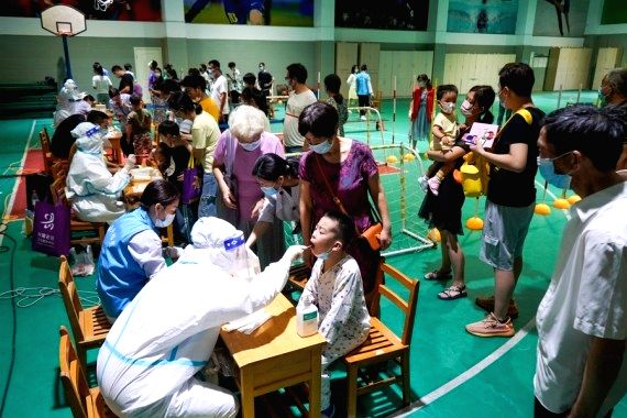 China reports 13 new locally transmitted Covid cases