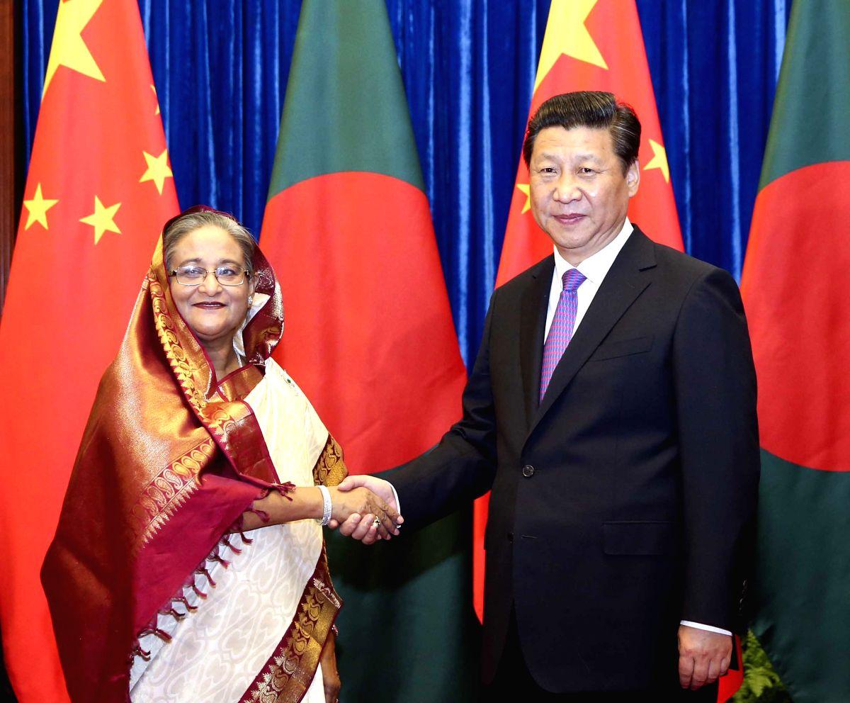 Chinese President Xi Jinping (R) meets with Bangladeshi Prime Minister Sheikh Hasina. (Photo: Xinhua/Ding Lin/IANS)