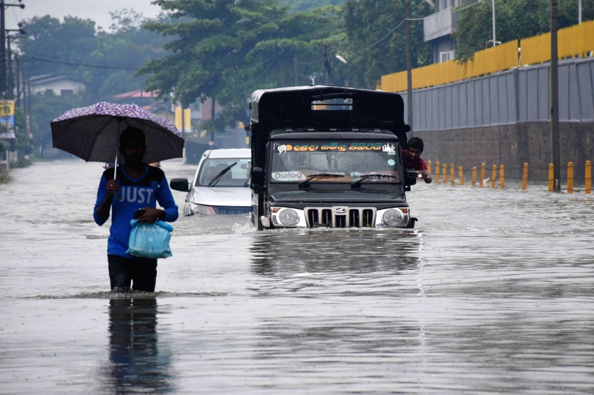 COLOMBO, May 23, 2018 (Xinhua) -- Vehicles are seen in flood water in suburban areas of Colombo, Sri Lanka, on May 23, 2018. The death toll from high winds and rains which lashed out across Sri Lanka since Saturday reached eight on Tuesday while over