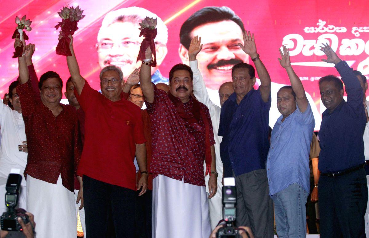 COLOMBO, Nov. 13, 2019 (Xinhua) -- Gotabaya Rajapaksa (2nd L), Sri Lanka's presidential candidate of the main opposition Sri Lanka Podujana Peramuna (SLPP), attends a final campaign rally in Homagama, outskirts of Colombo, Sri Lanka, on Nov. 13, 2019