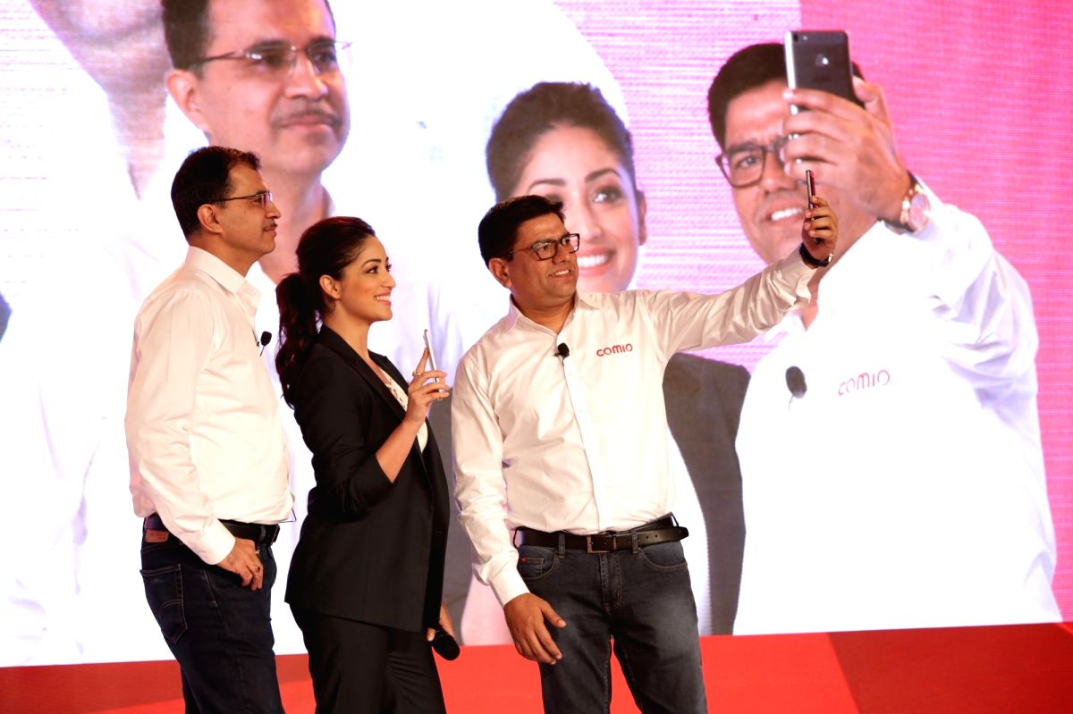 Comio CEO Sanjay Kalirona along with actress Yami Gautam at the launch of Comio smartphone in New Delhi, on August 18, 2017.