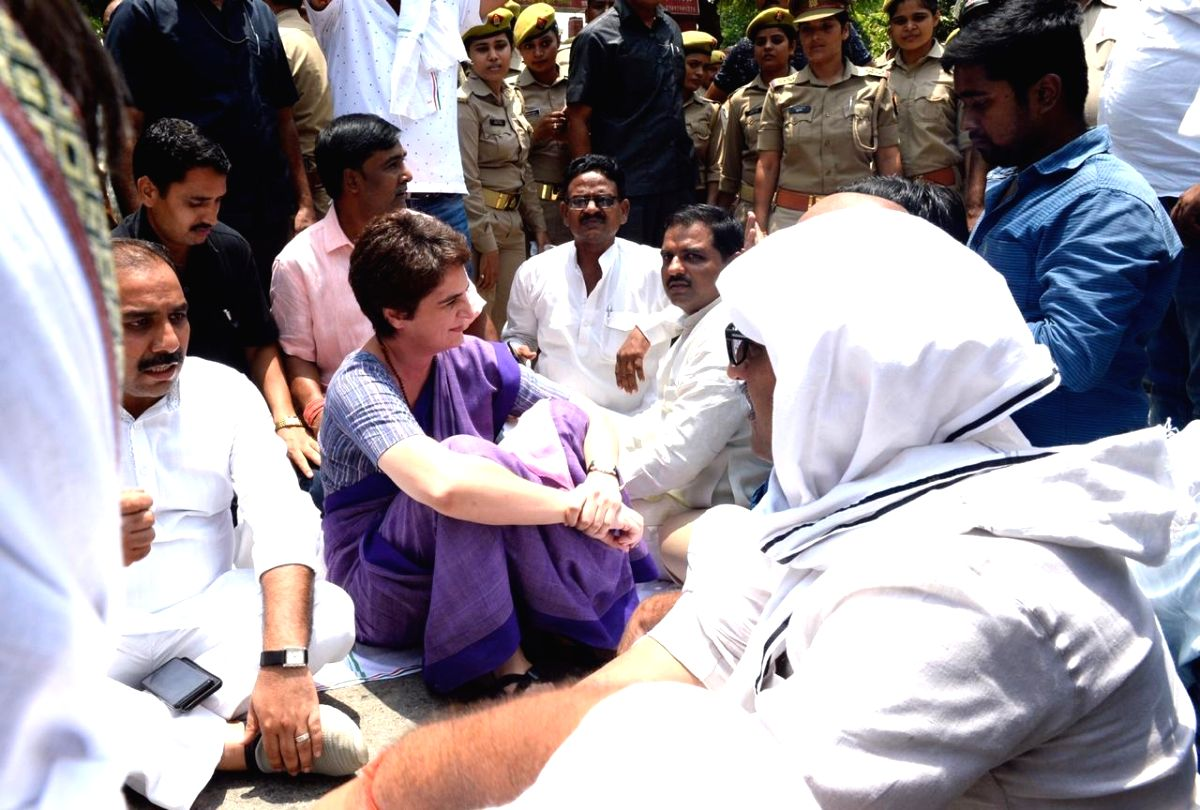 Congress General Secretary Priyanka Gandhi accompanied by party supporters stage a sit-in demonstration after she was stopped for Ubhbha village in Mirzapur