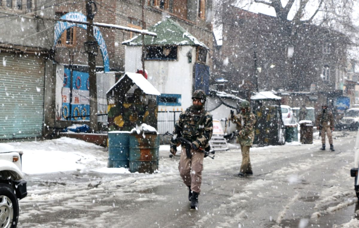 CRPF personnel conduct search operations amid snowfall after two militants were spotted by an alert sentry at the observation post of 23rd battalion of the CRPF in Karan Nagar area of ...