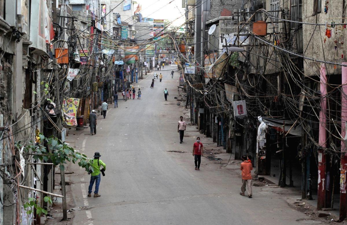 Delhi: Deserted view of Sadar Bazar market during the one week lockdown imposed by Delhi CM Arvind Kejriwal in new Delhi on Tuesday April 20, 2021.(Photo: Wasim Sarvar/IANS)