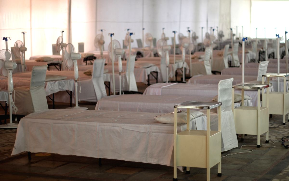 Delhi: Sikh volunteers set up a temporary Covid care centre (Guru Teg Bahadur Covid Care Center) with 200 beds with Oxygen at Gurudwara Rakab Ganj in new Delhi on Tuesday May 04, 2021 (Photo: Wasim Sarvar/IANS)
