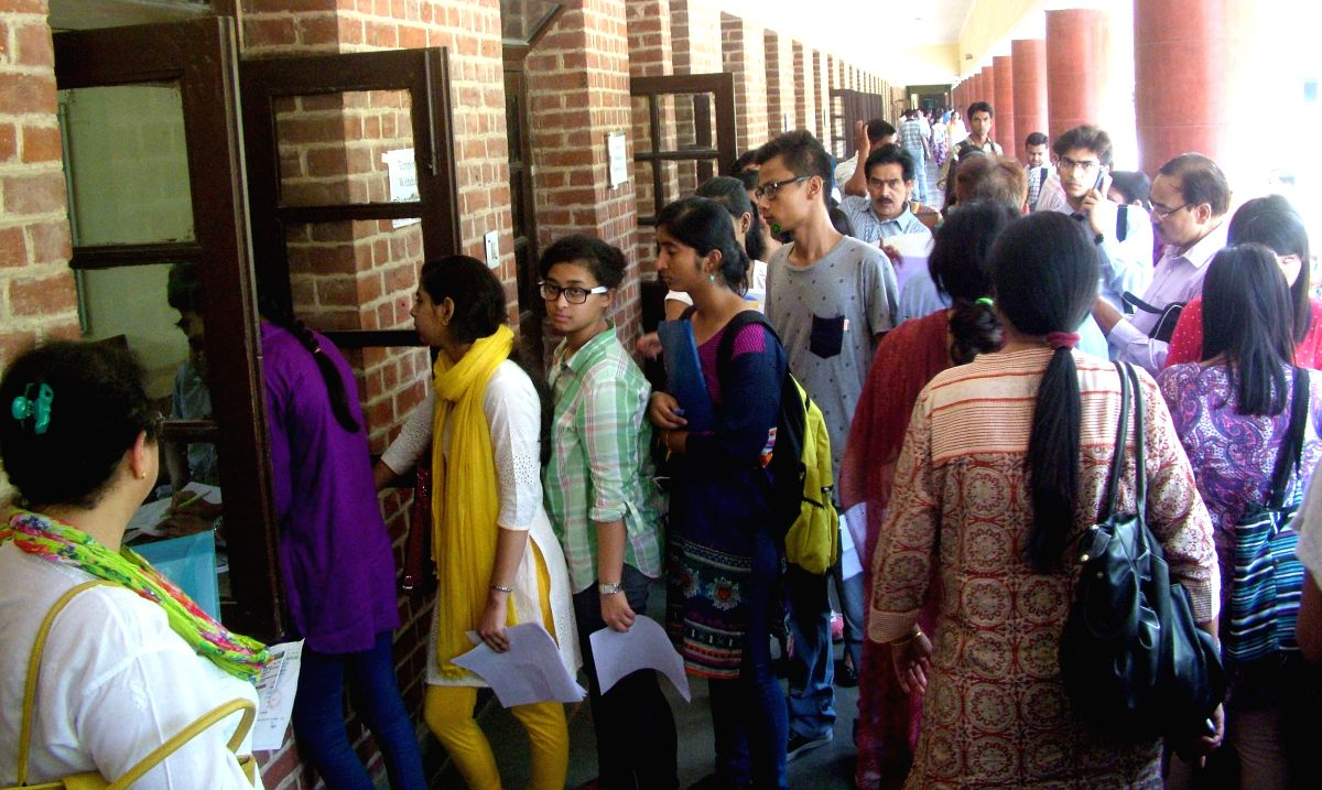 Delhi: Students arrive at a Delhi University college to submit their admission forms after the release of second cut off list at North Campus in Delhi on June 30, 2015.