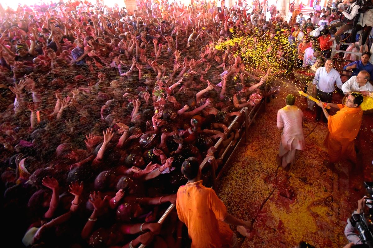 Devotees celebrate Holi at Govind Dev Ji Temple in Jaipur.