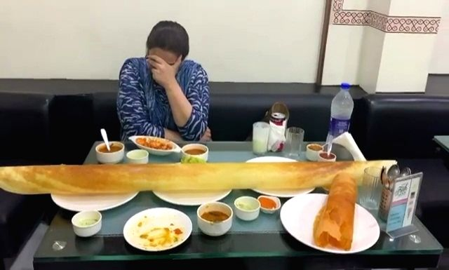 Ditching the diet, actress Sara Ali Khan and her actress mother Amrita Singh gorged on a giant dosa. Taking to Instagram, Sara recorded a video, where Amrita is seen sitting with scrumptious delicacies laid on the table.