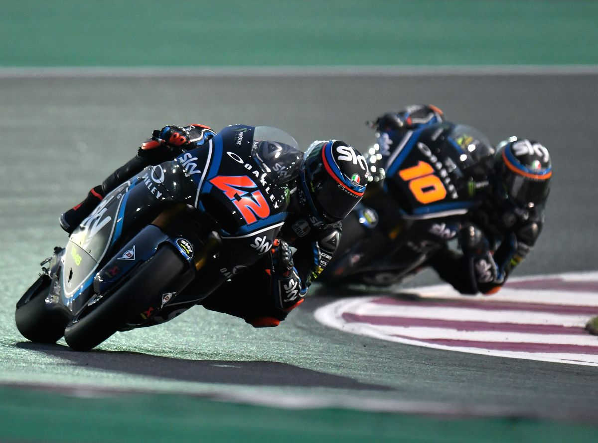 DOHA, March 18, 2018 (Xinhua) -- Italian Moto2 rider Francesco Bagnaia (L) of SKY Racing Team VR46 competes in the qualifying session during the 2018 MotoGP Grand Prix of Qatar in Losail Circuit of Doha, capital of Qatar, on March 17, 2018. (Xinhua/N