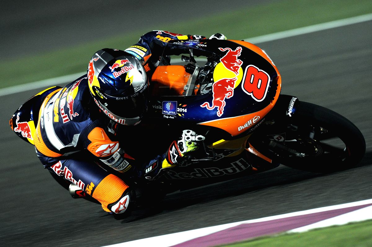 DOHA, March 24, 2014 (Xinhua) -- Winner Red Bull KTM Ajo Australian driver Jack Miller competes during the Moto3 group of the Qatar MotoGP Grand Prix at the Losail International circuit in Doha, capital of Qatar, March 23, 2014. (Photo: Xinhua/Chen S