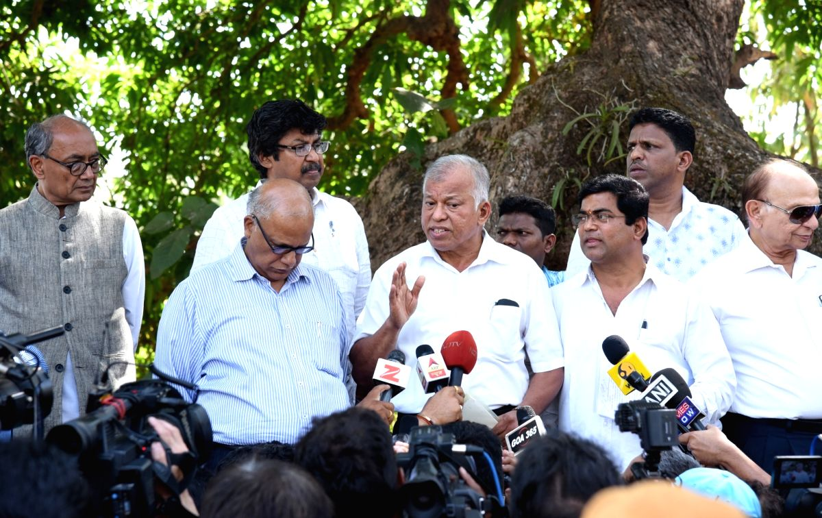 Dona Paula: Congress Goa Chief Luizinho Faleiro talks to press after meeting with Goa Governor Mridula Sinha outside Raj Bhavan in Dona Paula, Goa on March 14, 2017. Also seen Congress leaders ...