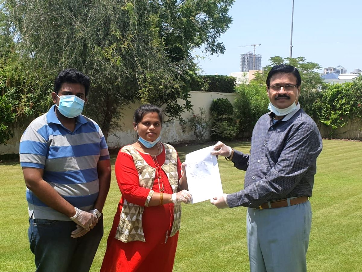 Dubai's Masala King & Al-Adil Trading LLC Group head Dhananjay M. Datar gives tickets to a stranded Indian couple.