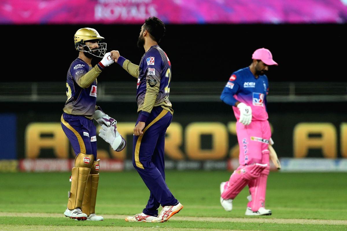 Dubai: Varun Chakaravarthy of Kolkata Knight Riderscelebrates the wicket of Rahul Tewatia of Rajasthan Royals with Dinesh Karthik captain of Kolkata Knight Riders during match 12 of season 13 of the Dream 11 Indian Premier League (IPL) between the Ra
