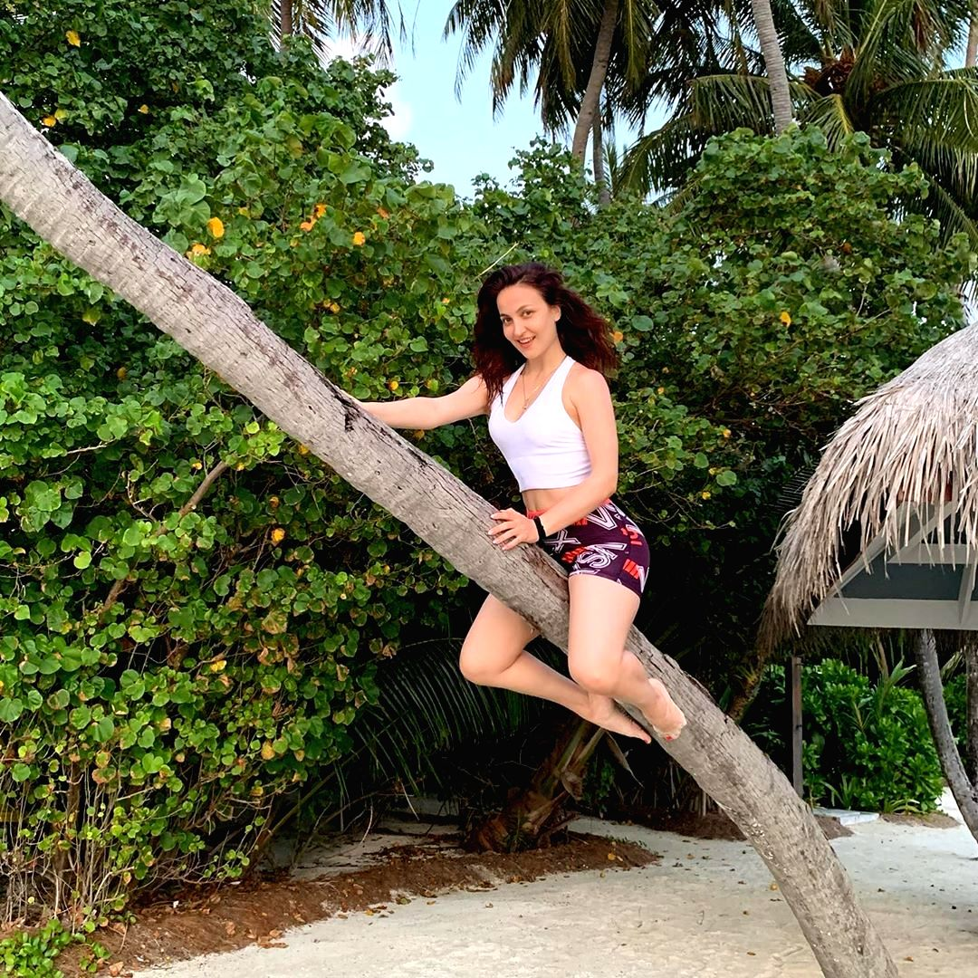 Elli AvrRam turns a flying witch riding the stick on Halloween.