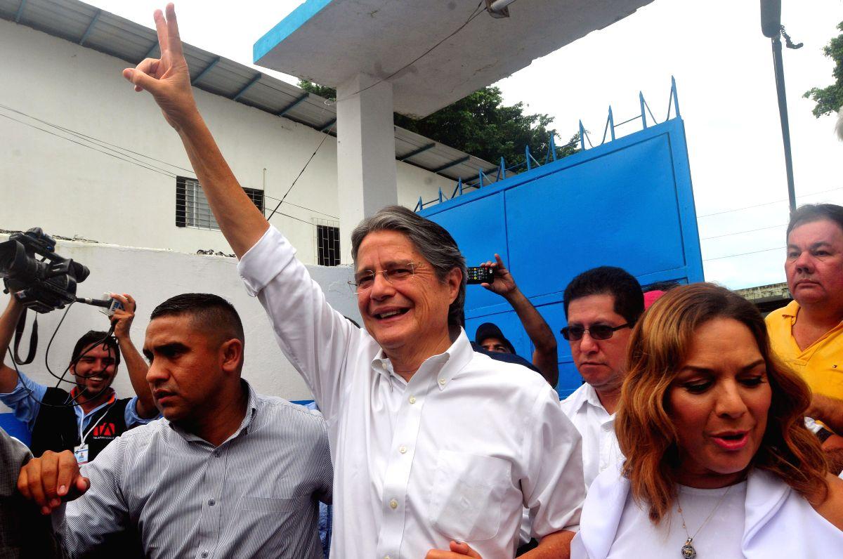 Ex-banker declares victory in Ecuador Prez run-off