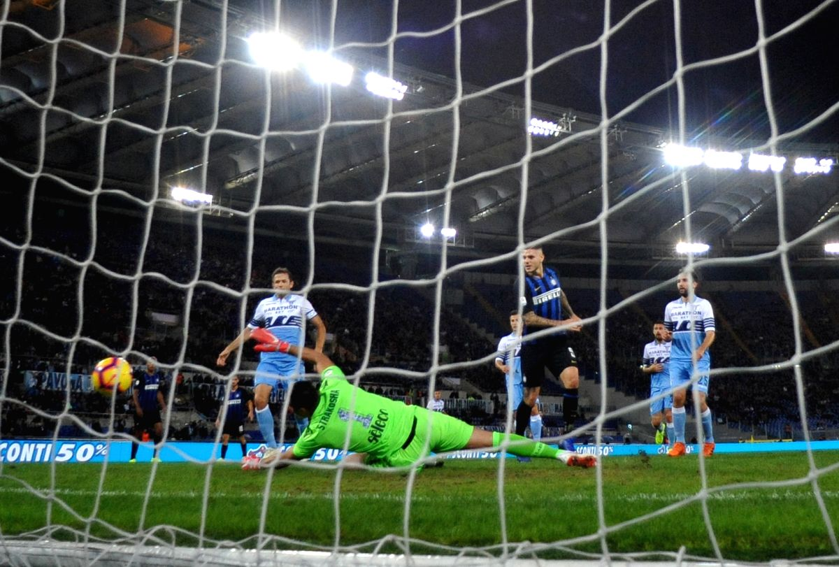 :FC Inter's Mauro Icardi (3rd R) scores during the 2018-2019 Serie A soccer match between FC Inter and Lazio in Rome, Italy