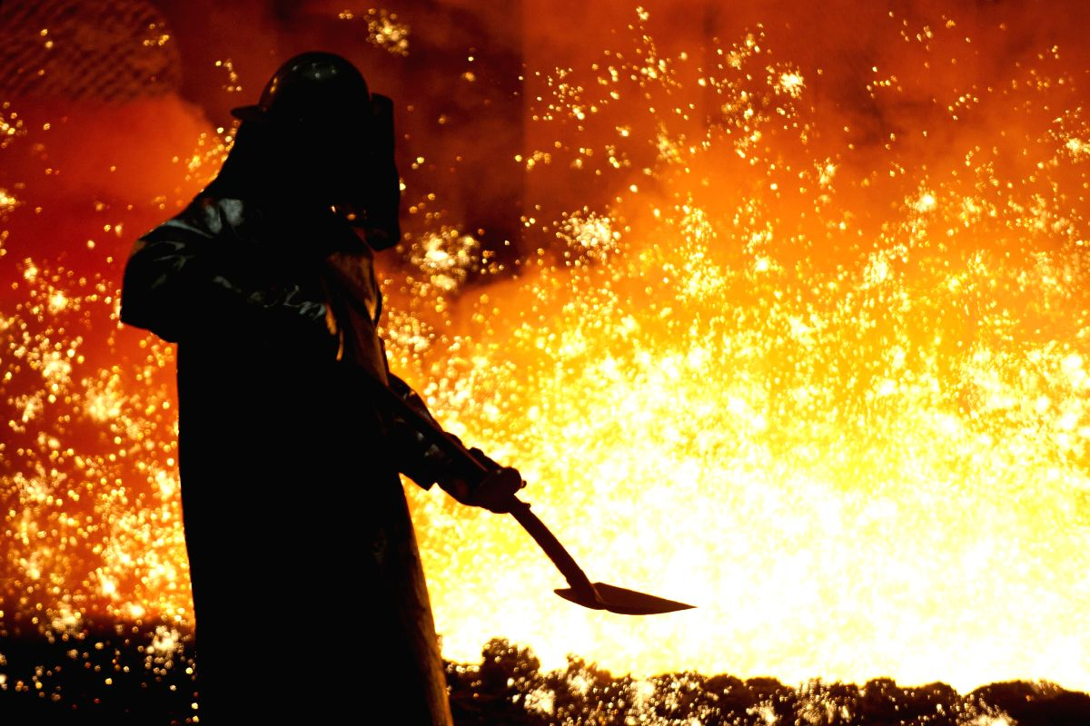 FILE: An operator works on a blast furnace of the Salzgitter Ag in Salzgitter, Lower Saxony, Germany, on 21 March 2012. The steel industry in Germany continues to suffer due to the bad economic situation. In February, the crude steel production sank