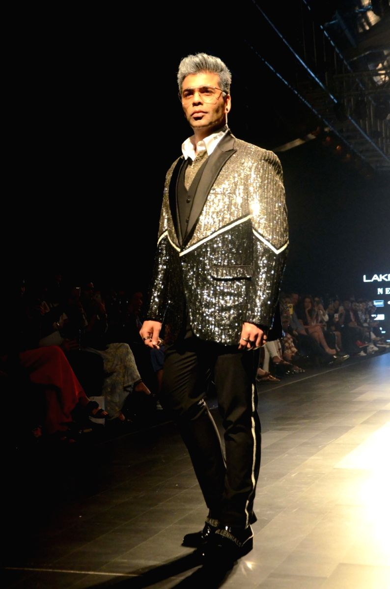 Karan Johar has never shied away from shimmer or glitter. We don't think anyone else can pull this off easily