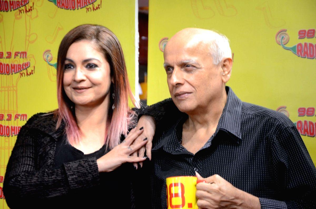 Filmmaker Mahesh Bhatt with his daughter and actress Pooja Bhatt