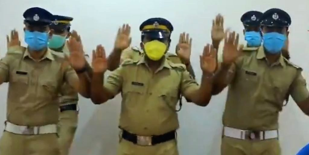 Kerala Police team shows the need for washing ones hands with soap to keep out the raging Covid -19 out.