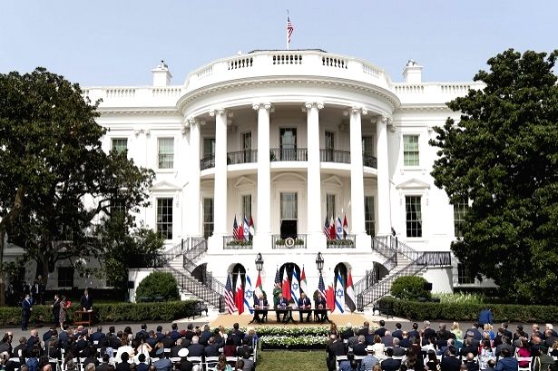 Foreign Minister Abdullatif bin Rashid Al-Zayan, Israel Prime Minister Benjamin Netanyahu and United Arab Emirates Foreign Minister Abdullah bin Zayed Al Nahyan sign an agreement to set up diplomatic relations at the White House on Tuesday, September