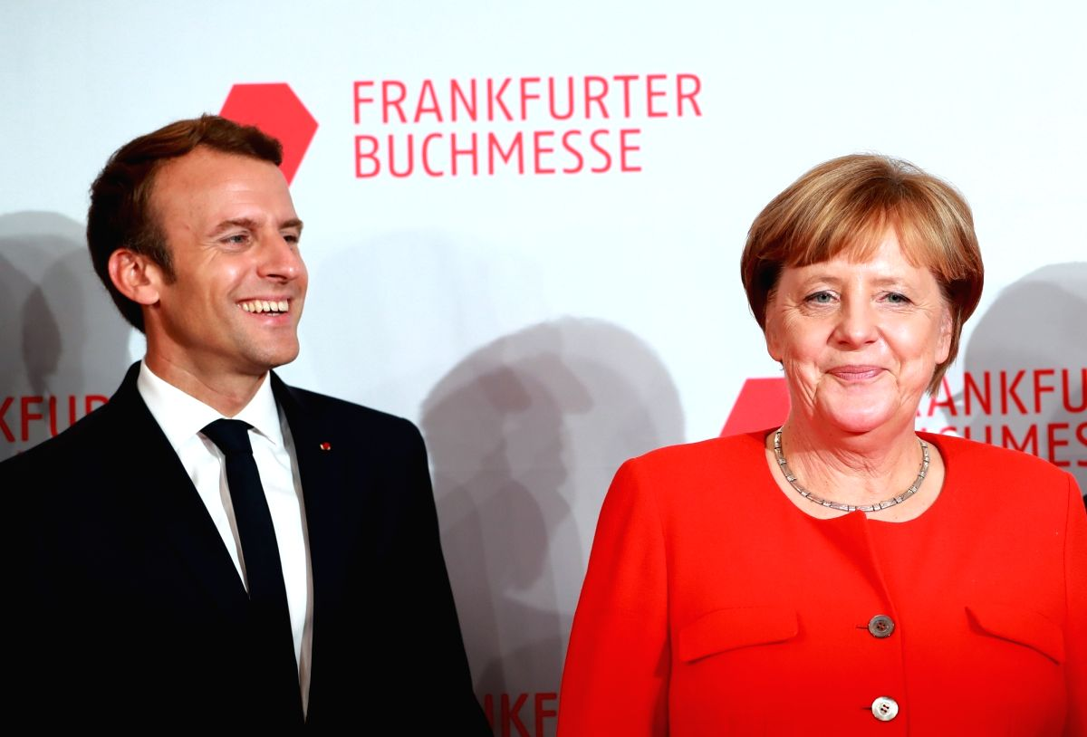 FRANKFURT, Oct. 10, 2017 - German Chancellor Angela Merkel (R) and French President Emmanuel Macron pose for photos as they arrive to open the 69th Frankfurt Book Fair in Frankfurt, Germany, on Oct. ...