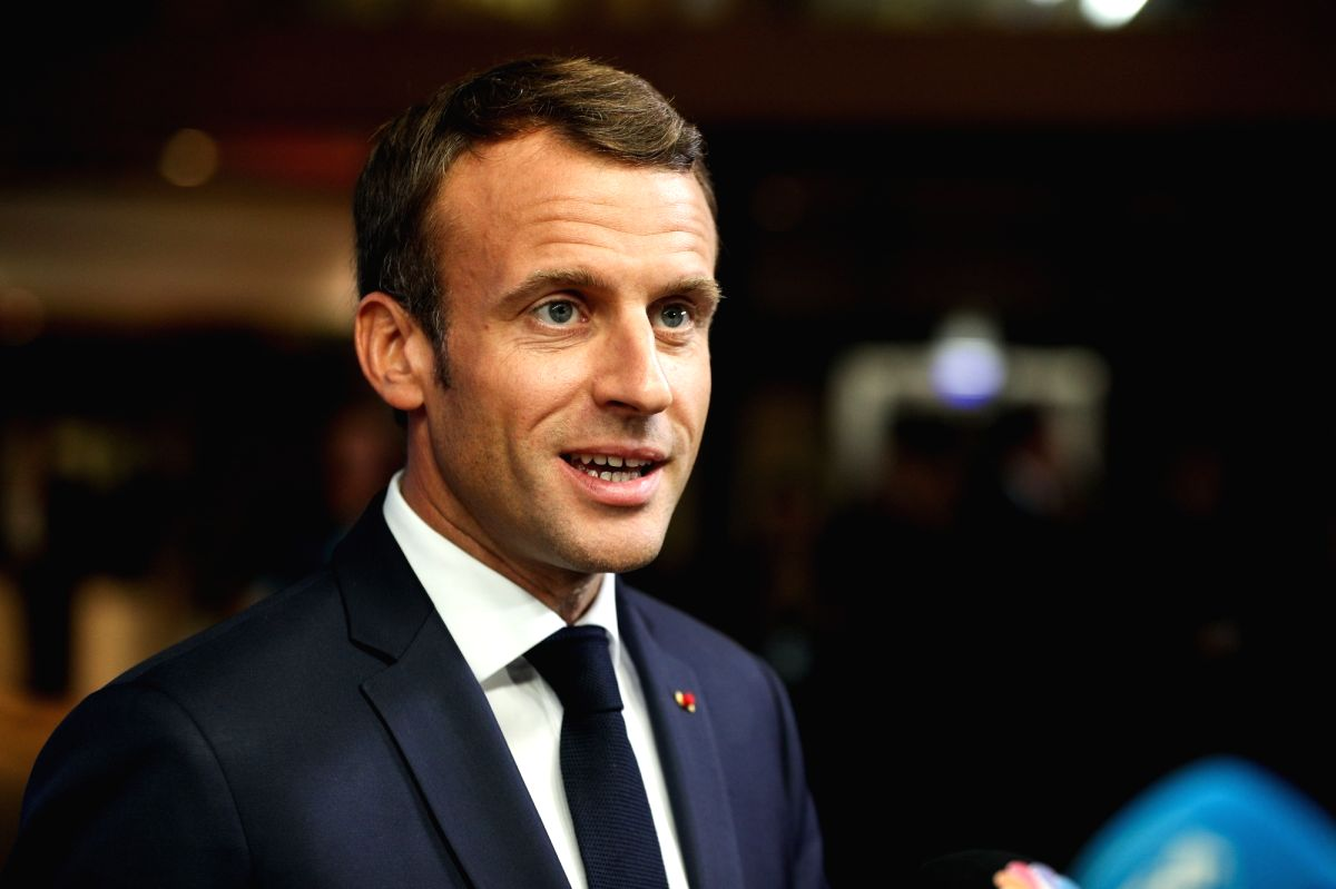French President Emmanuel Macron speaks to media at the European Council in Brussels, Belgium