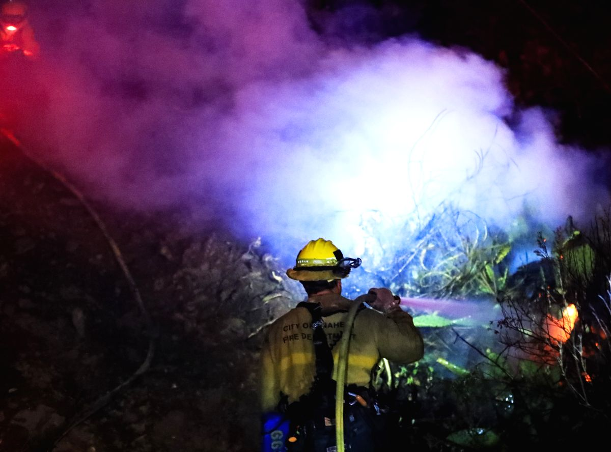 FULLERTON (U.S.), Oct. 31, 2019 (Xinhua) -- A firefighter works to put out a wildfire in Fullerton, California, the United States, on Oct. 30, 2019. As of Wednesday, as many as 10 brutal wildfires were burning throughout the Golden State. The latest