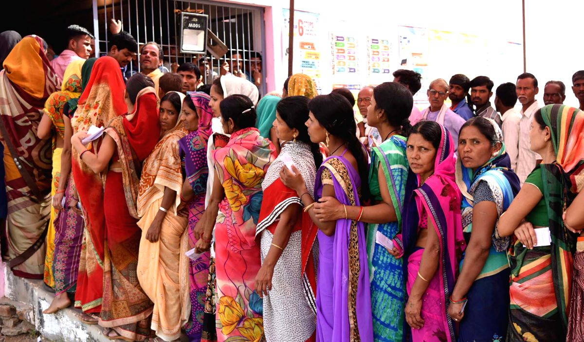 Gaykhuri: Voters stands in the queue to cast their votes during the fourth phase of 2019 Lok Sabha elections at a polling station in Gaykhuri, Balaghat of Madhya Pradesh, on April 29, 2019. (Photo: IANS/PIB)