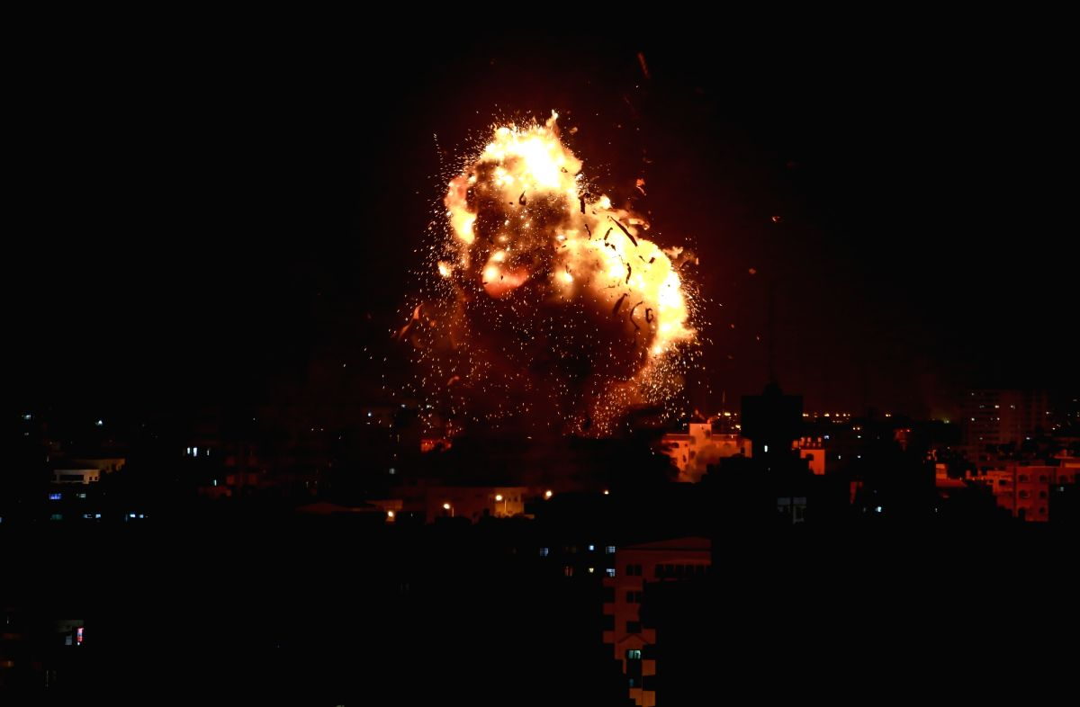 GAZA, Nov. 12, 2018 (Xinhua) -- Photo taken on Nov. 12, 2018 shows an explosion during an Israeli airstrike on Hamas-run television station Al-Aqsa Television in Gaza City. Israeli war jets struck with eight missiles on Monday night the building of A