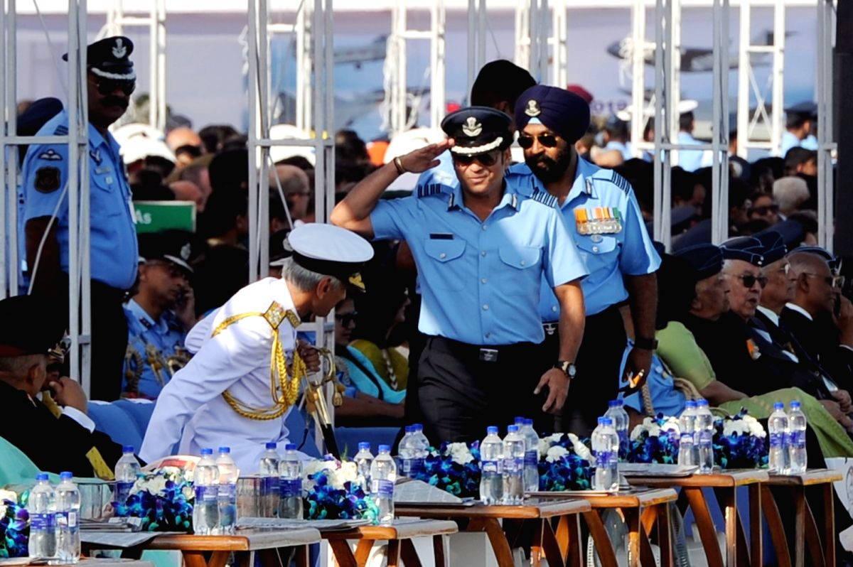 Ghaziabad: Navy Chief Admiral Karambir Singh and Cricket legend and honorary Group Captain Sachin Tendulkar during the 87th anniversary celebrations of the Indian Air Force (IAF) at Hindon Air Force Station in Ghaziabad, on Oct 8, 2019.