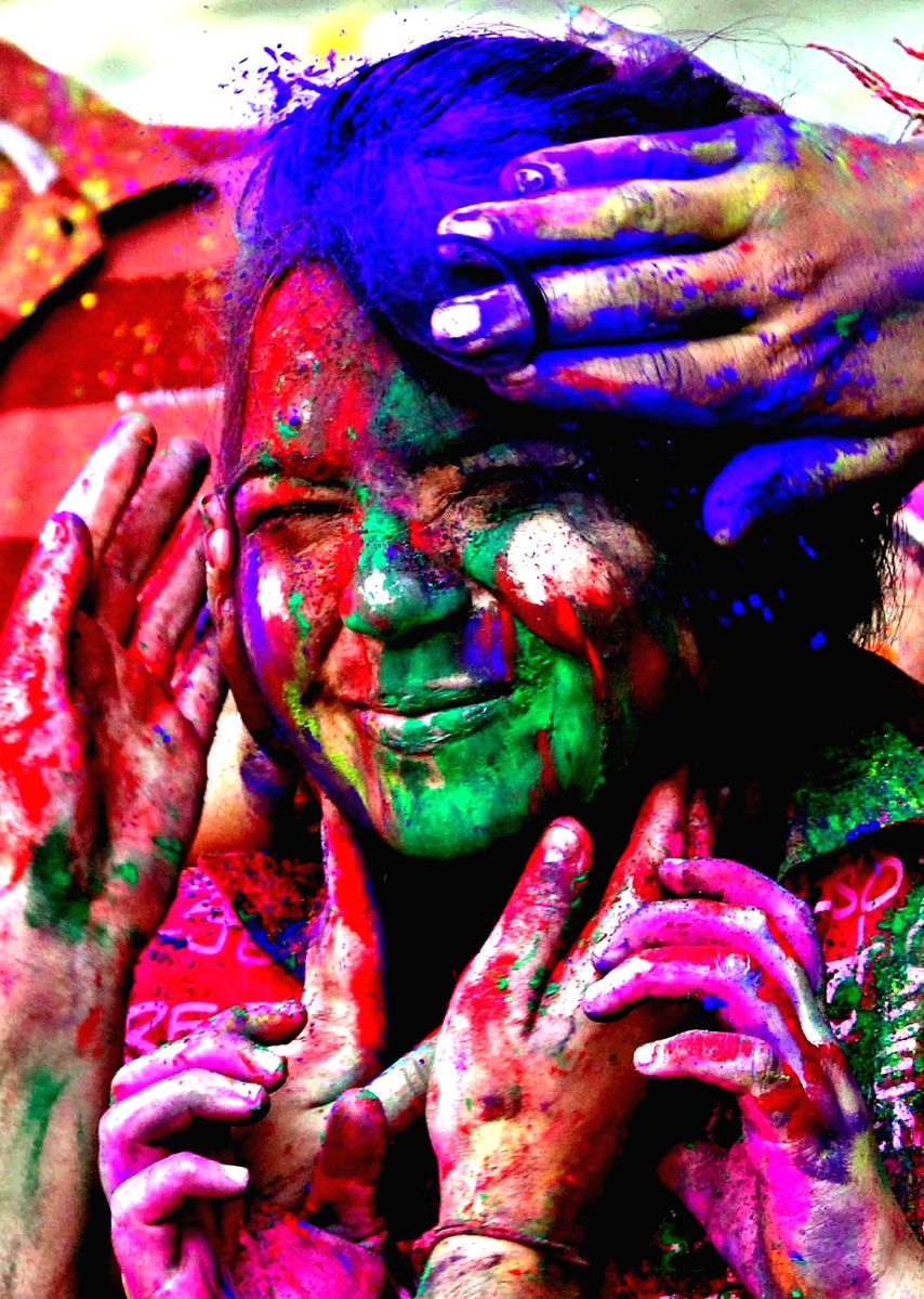 Girls play with colour to celebrate Holi