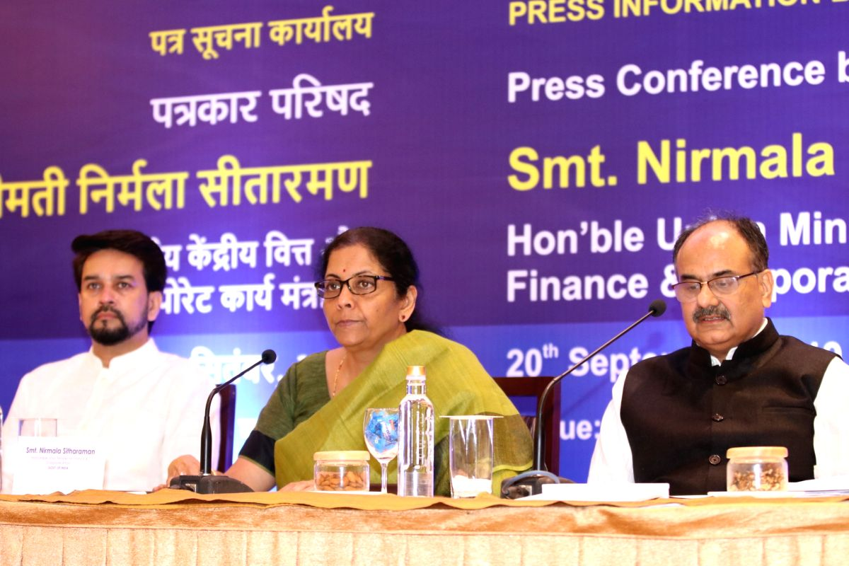 Goa: Union Minister for Finance & Corporate Affairs Nirmala Sitharaman addressing a press conference during the GST meet held at Goa on Sept. 20, 2019. Anurag Thakur ,Union Minister of State Finance and Corporate Affairs and Ajay Bhushan Pandey , Sec