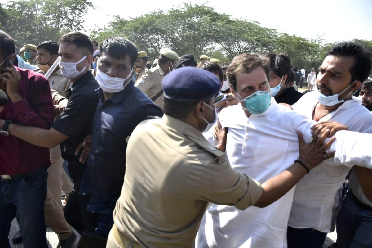 Greater Noida: Congress leader Rahul Gandhi being stopped by the UP police from marching towards Hathras to meet the family of the gang rape victim who died on Tuesday and whose dead-of-night cremation by the UP police has provoked nationwide outrage, in Greater Noida on Oct 1, 2020. Rahul Gandhi alleged today that he was pushed to the ground and lathi-charged when he and his sister Priyanka Gandhi Vadra were marching on the highway between Delhi and Uttar Pradesh after their convoy was stopped on its way to Hathras.