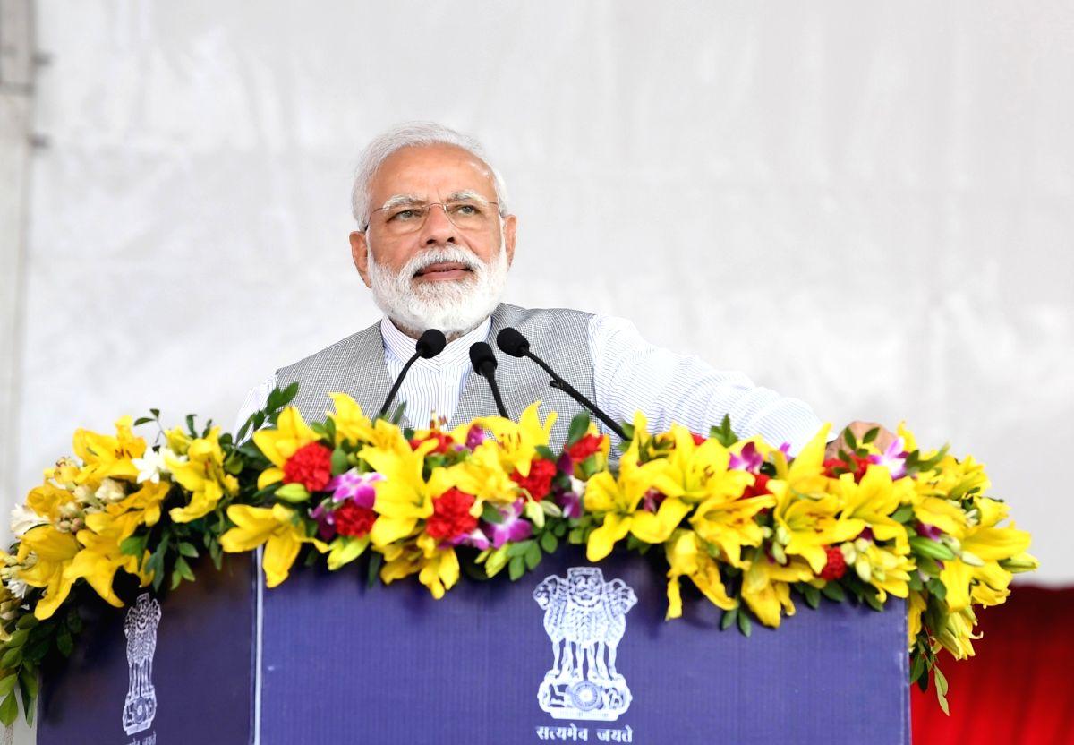 Greater Noida: Prime Minister Narendra Modi addresses during a programme at Greater Noida, Uttar Pradesh on March 9, 2019. (Photo: IANS/PIB)