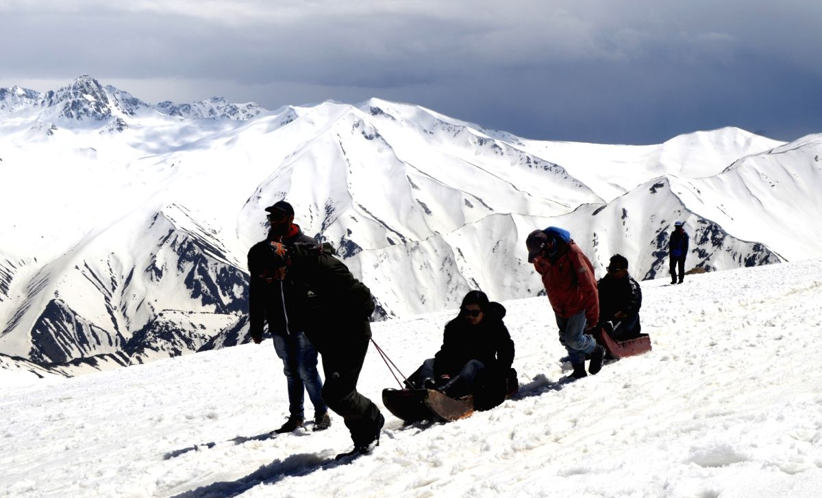 Gulmarg: Tourists enjoy sledge ride in Jammu and Kashmir's Gulmarg, on May 5, 2019.