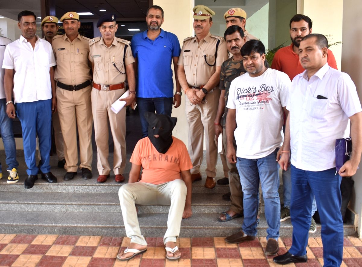 Gurugram: One of the three notorious gangsters arrested by the Crime branch of Gurugram police after a shootout in the national capital's DwarkaExpressway, on July 17, 2019. Two other criminals received gun shots during an encounter with the police a