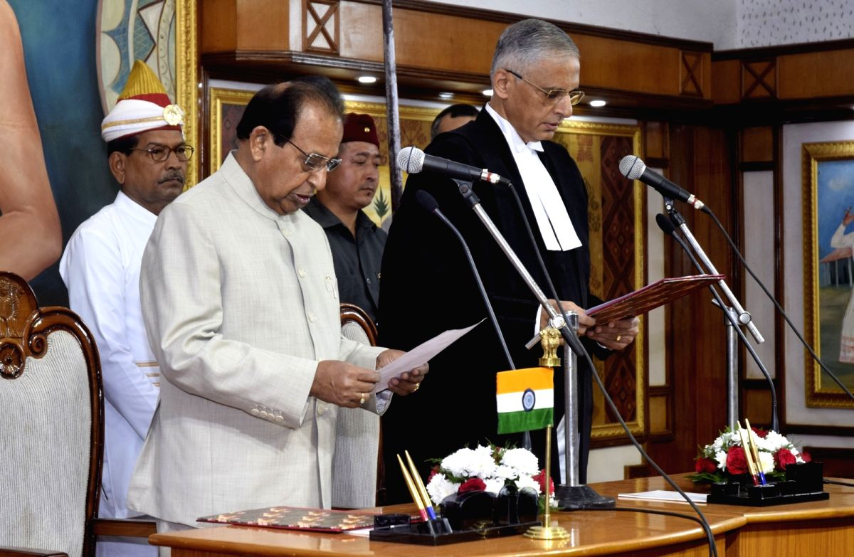 :Guwahati: Assam Governor Jagdish Mukhi administers the oath of office to Justice Ajjikuttira Somaiah Bopanna, as the new Chief Justice of Gauhati High Court at Raj Bhavan in Guwahati on Oct 29, ...