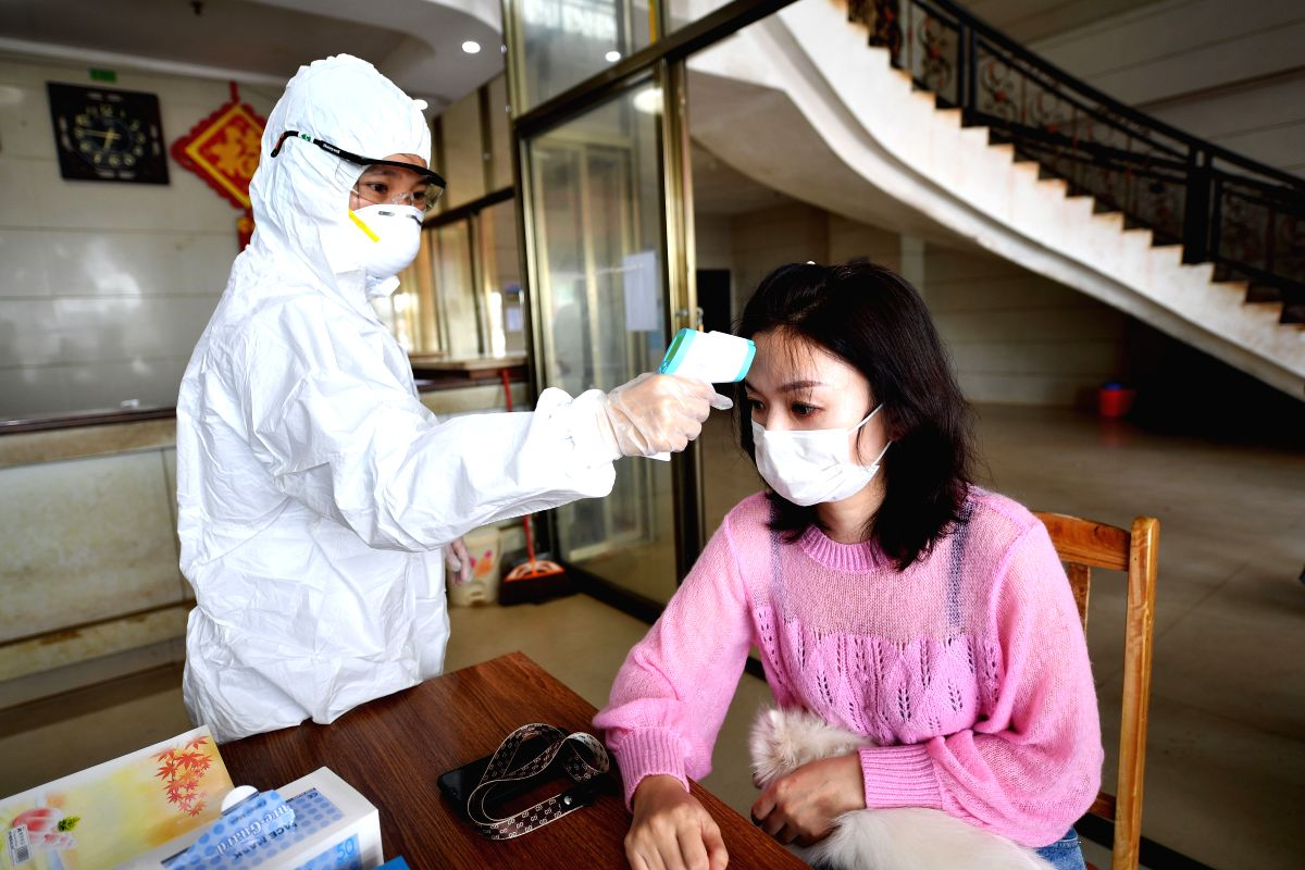 HAIKOU, Feb. 7, 2020 (Xinhua) -- A medical worker from Haikou of south China's Hainan Province measures body temperature of a passenger at an observation point in Xuwen County of Zhanjiang City, south China's Guangdong Province, Feb. 6, 2020. Qiongzh